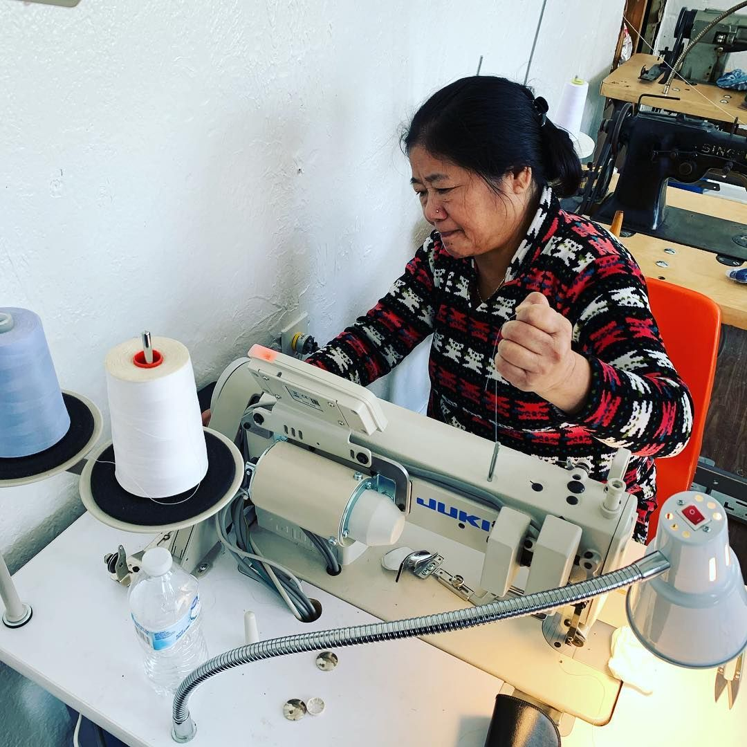photo of refugee woman at sewing machine