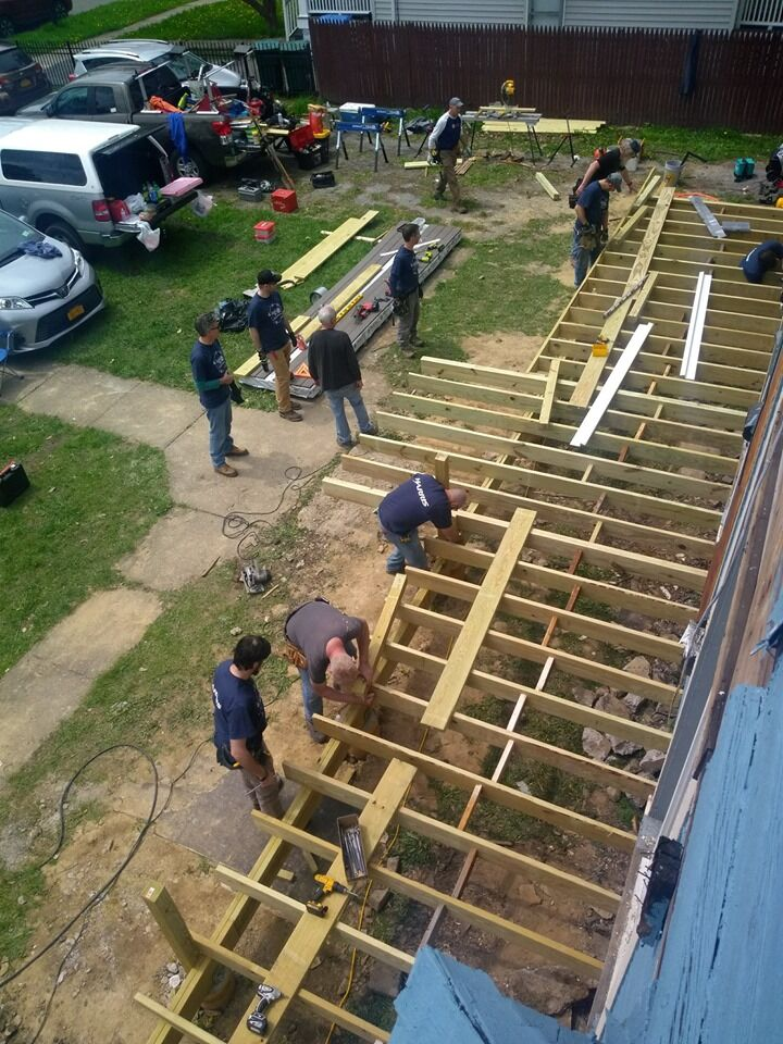 photo of workers on exterior home construction