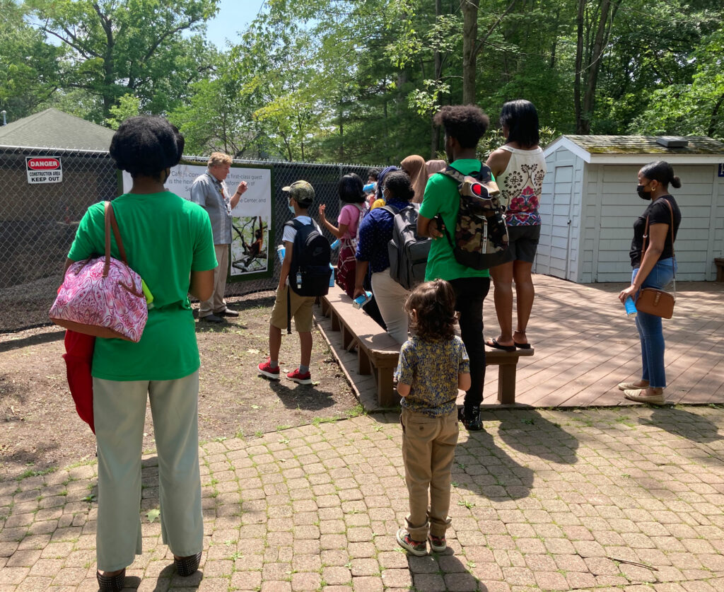 phot of ARSEO students listening to a talk at the Seneca Park Zoo